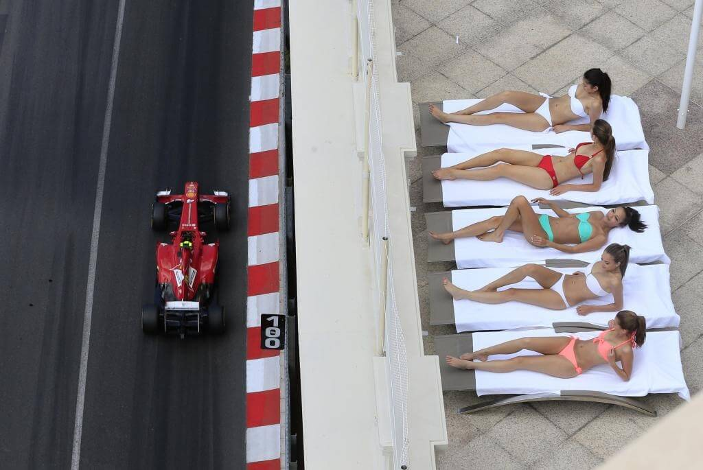 Models sunbathing during the Monaco Grand Prix