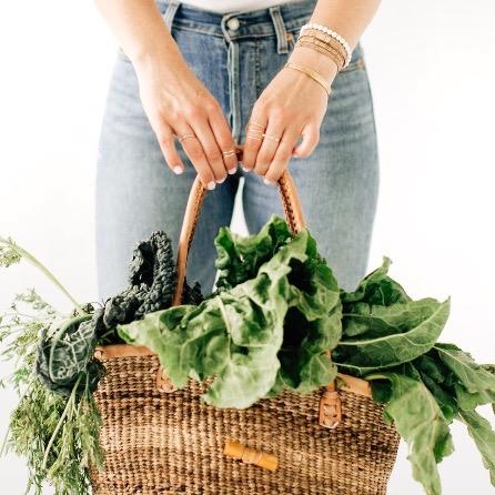 holding basket with vegetables.jpeg