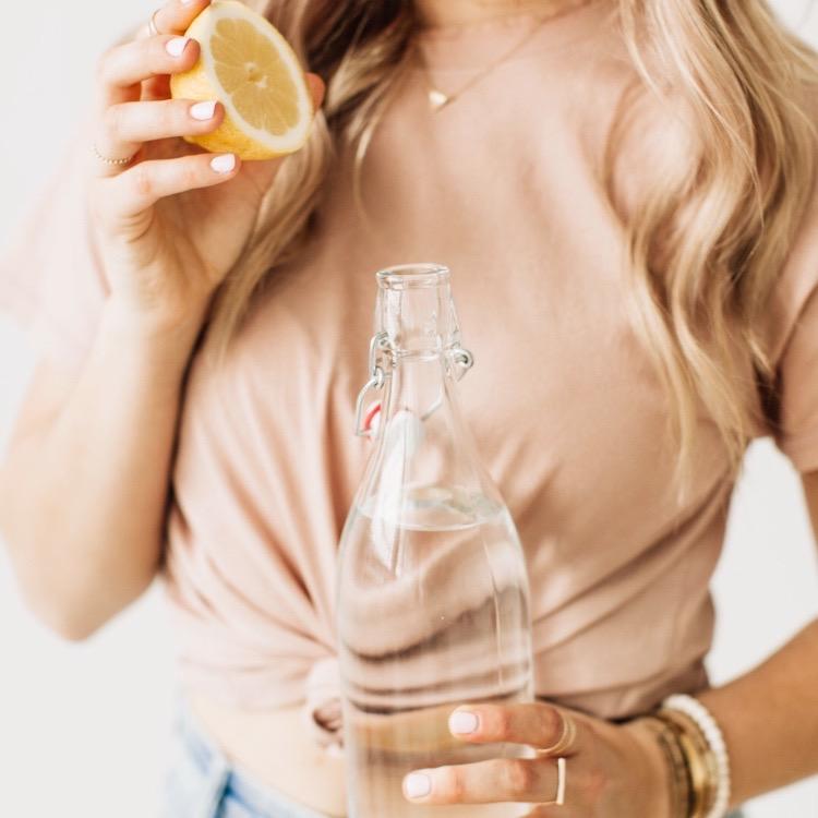 glass water bottle and lemon half .jpeg