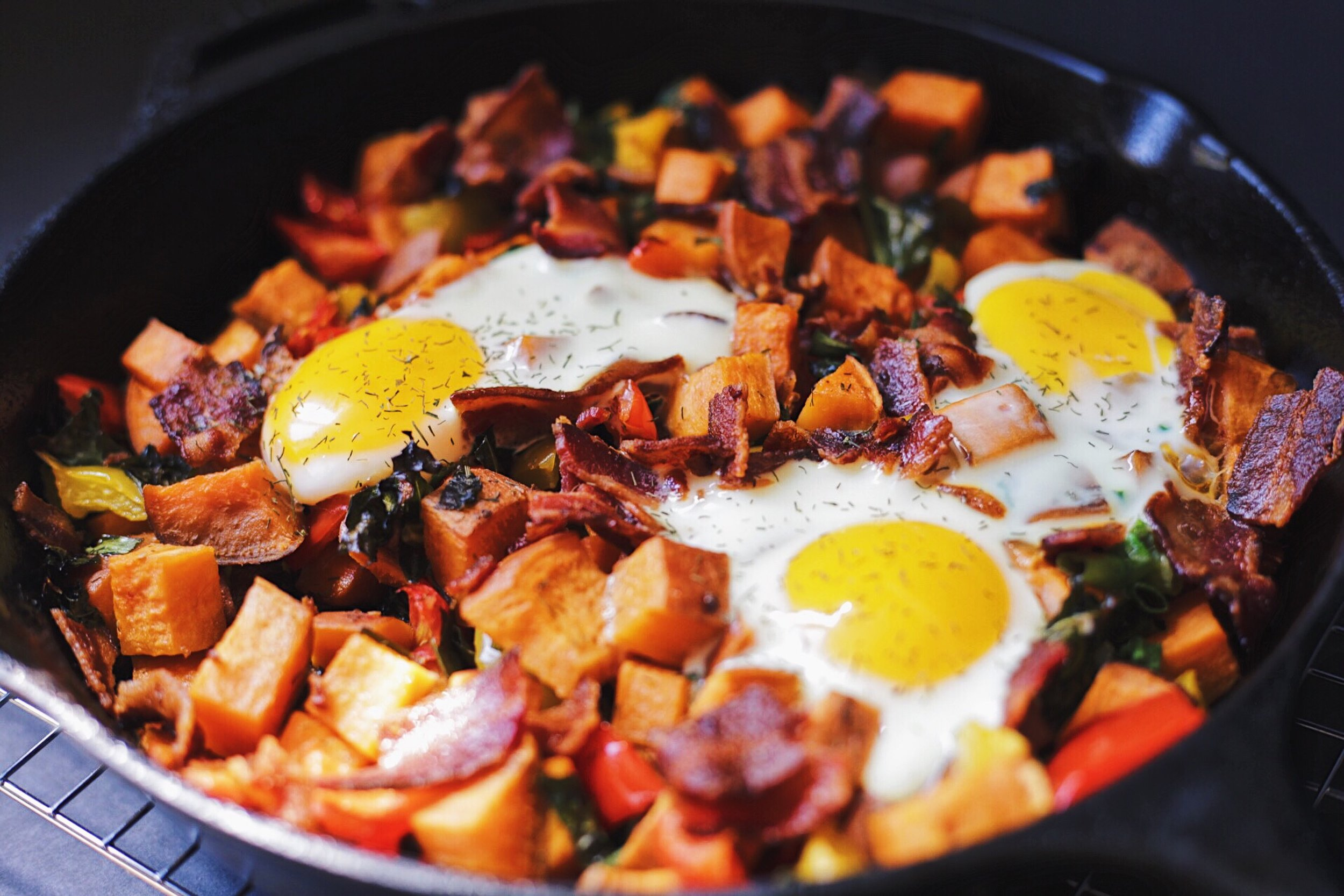 sweet potato hash with bacon and spring veggies