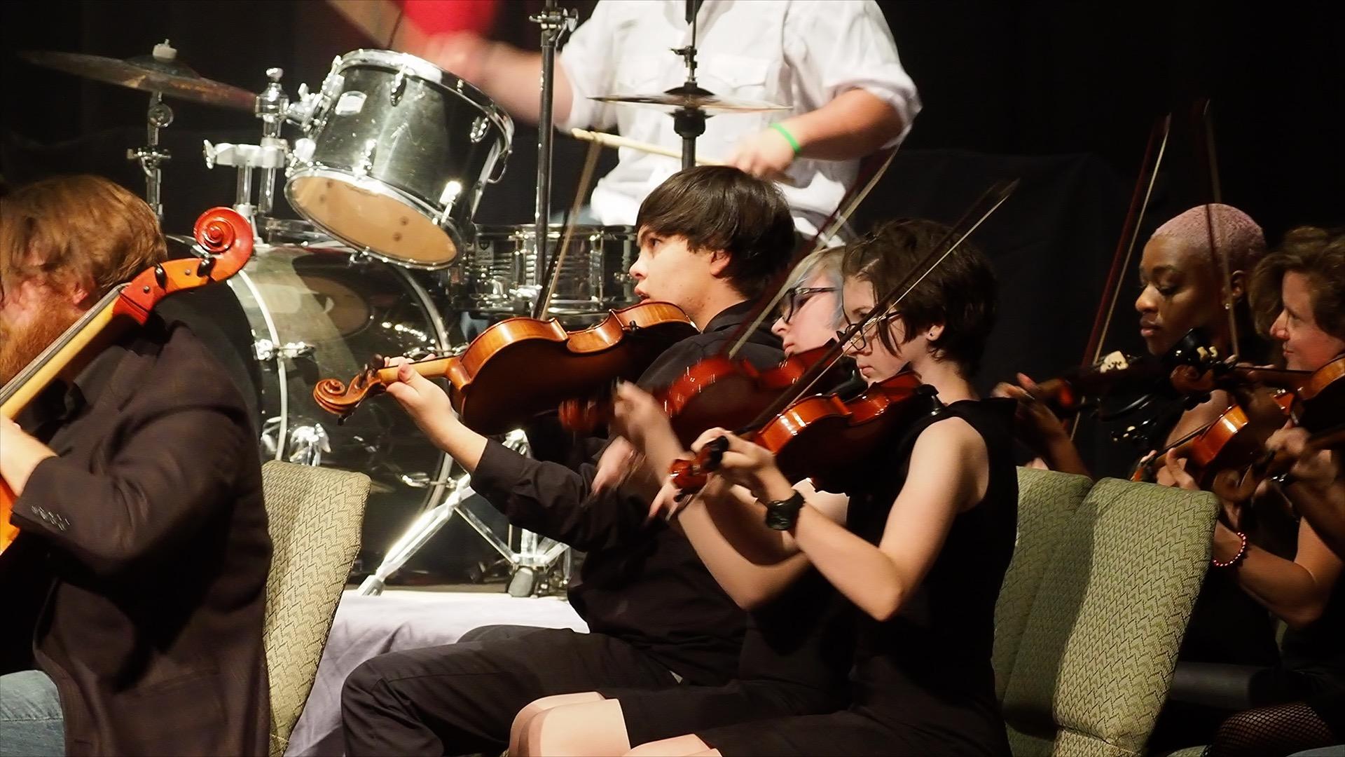 String Players Side Shot Kevan in Background.jpg