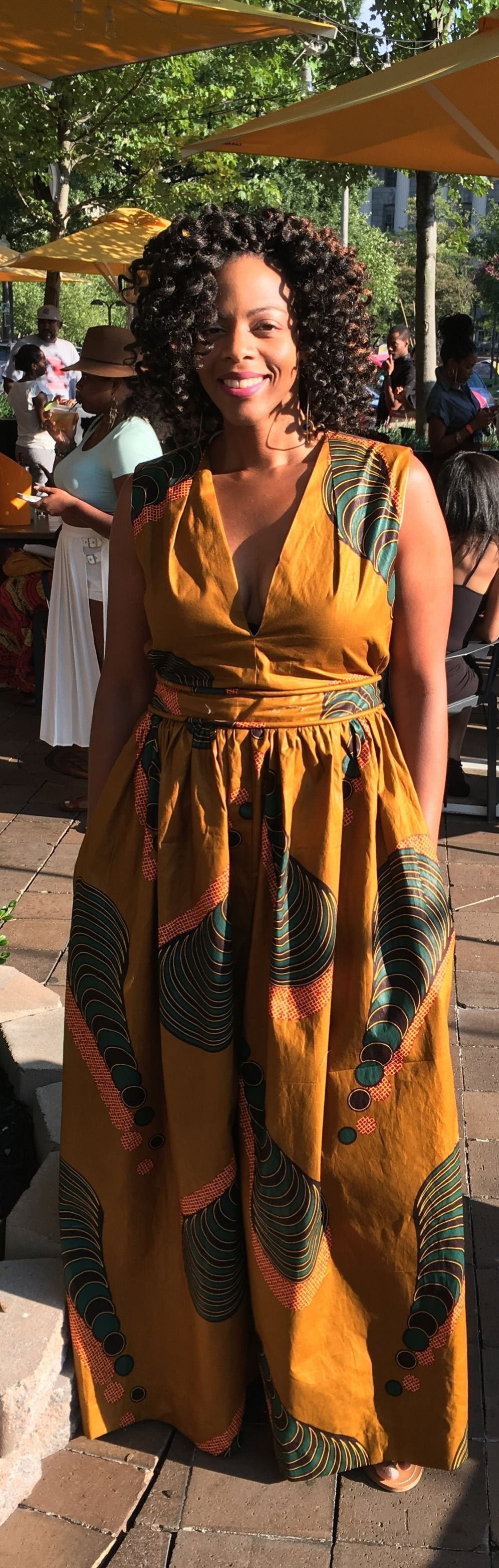 The Ankara Maxi Dress - For the 4th project, I used an ankara wax print to make a maxi dress with a cut-out in the back.  I took the bodice from Simplicity 1059 and made a cut out in the back. The skirt was two long rectangles.  The front had a slit in the center (are you seeing the theme here?).  This was attached to a waistband with piping.  I added pockets to the side.  One huge lesson from this dress: always make sure you have an adequate 'exit plan' for any garment.  As much as I love this dress, it requires an amazing feat of  acrobatics to get into and out of it.   The next time I make something like this, I will definitely be more thoughtful about the zipper length and placement.