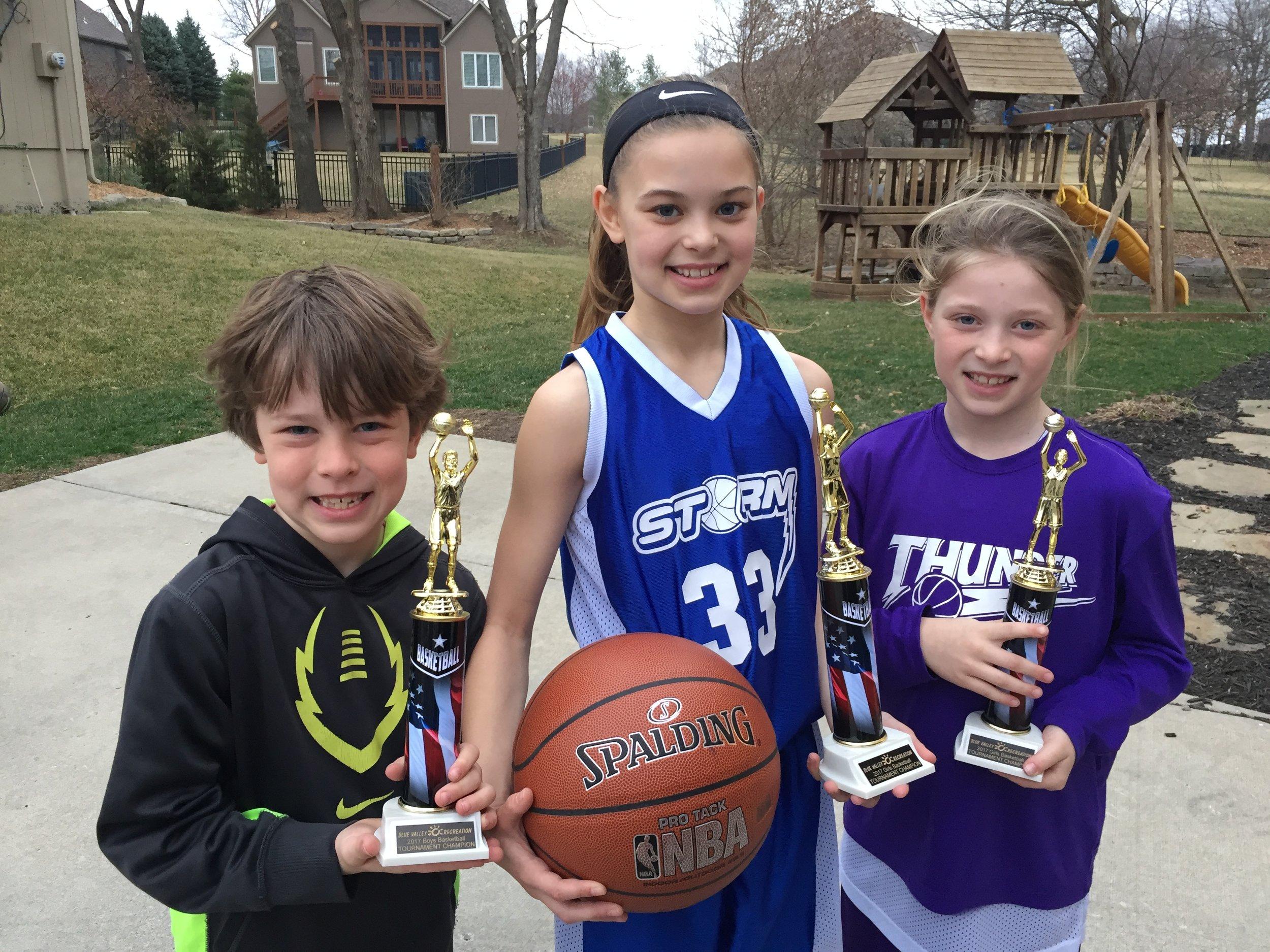 Kids with trophies.JPG