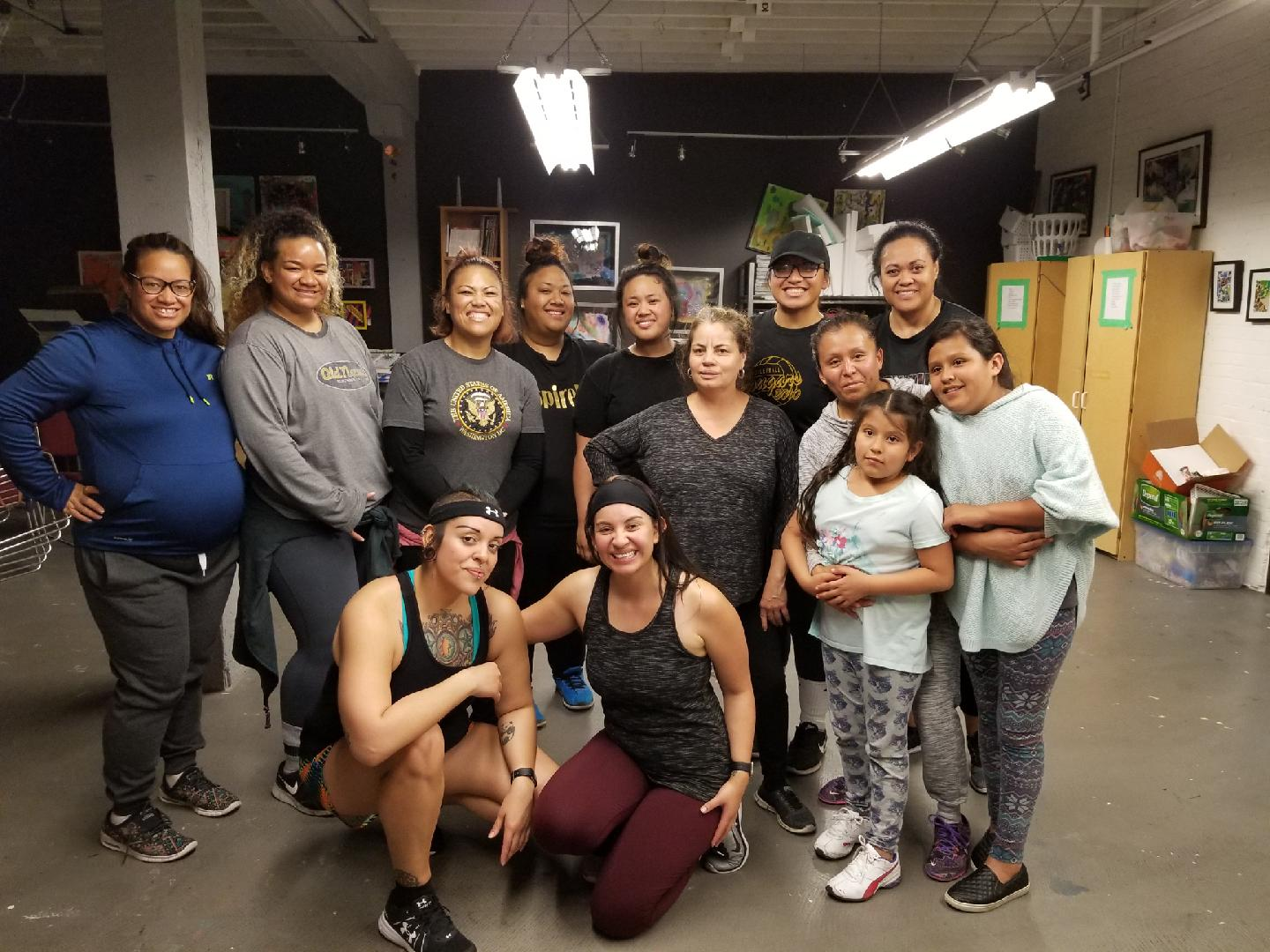 "Phoebe Galvez, Rape Recovery Center staff therapist and organizer of ""Speak, Swing, Sway: Zumba with inSpire Up"" poses with all who attended for an evening of body love and movement."