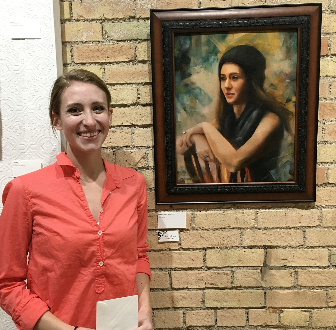 "Heather Olsen, 1st place winner of ""Coppice: An Art Exhibition,"" is pictured with her winning painting titled ""Looking Forward to the Future."""