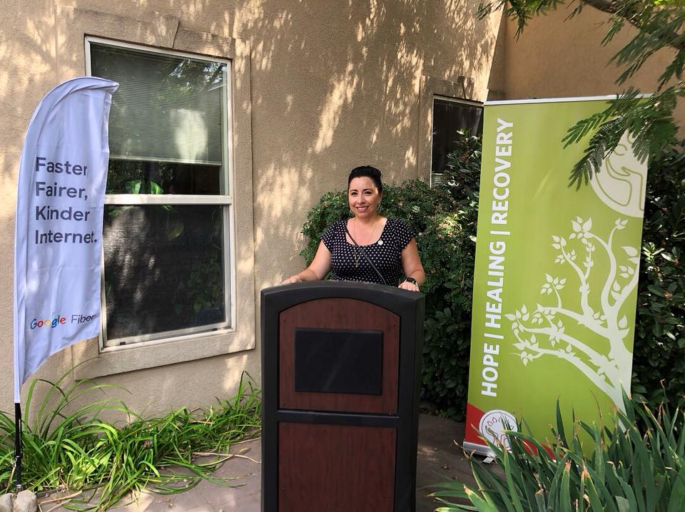 Representative Angela Romero speaks at the Rape Recovery Center's Google Fiber Community Connection celebration