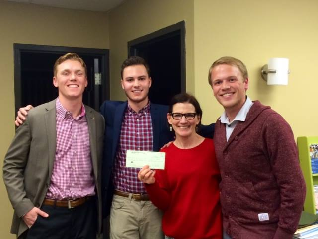 Members of Beta with former RRC Executive Director, presenting their first donation in 2014.