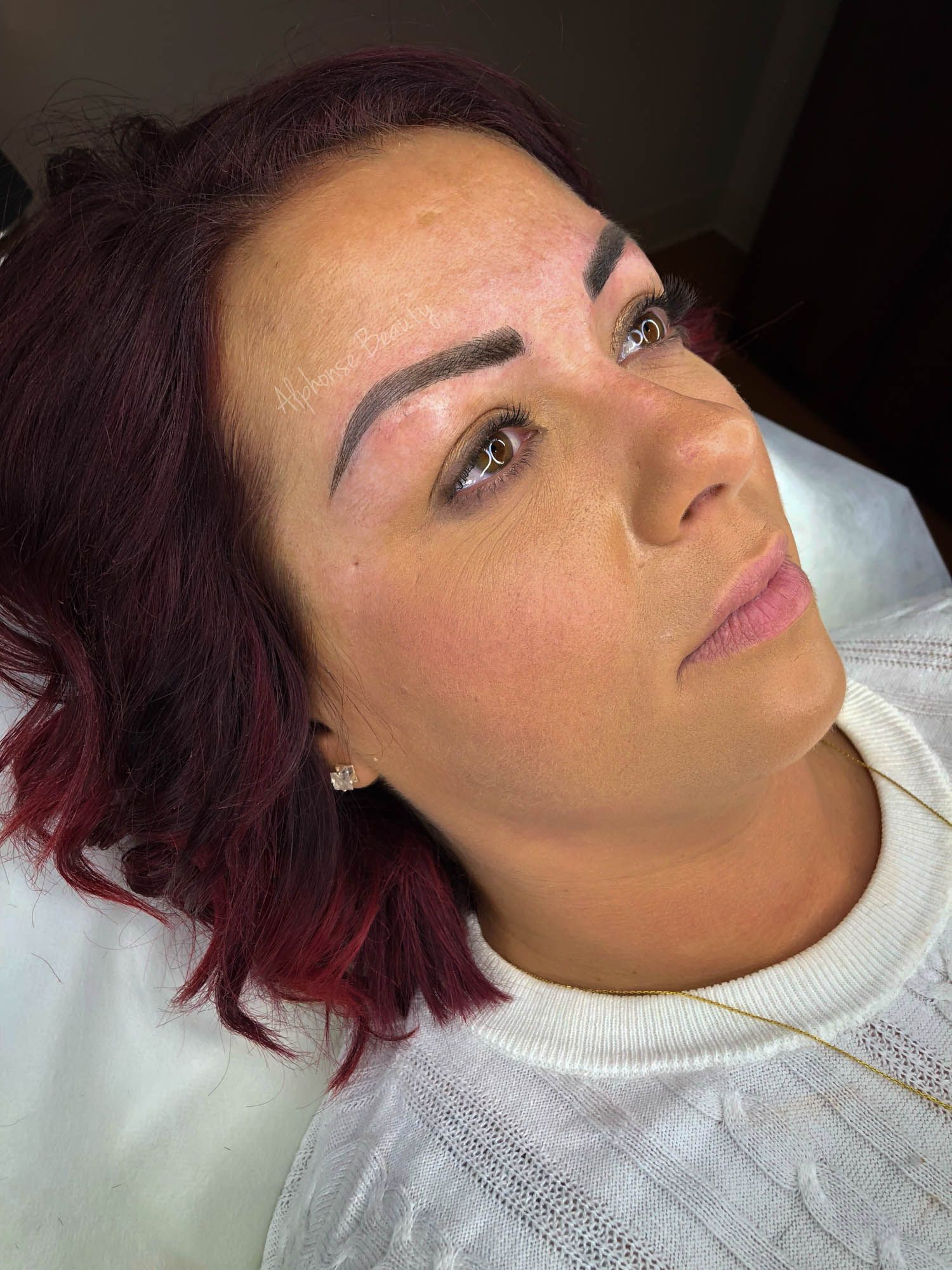 Bold and filled in eyebrows after microblading procedure