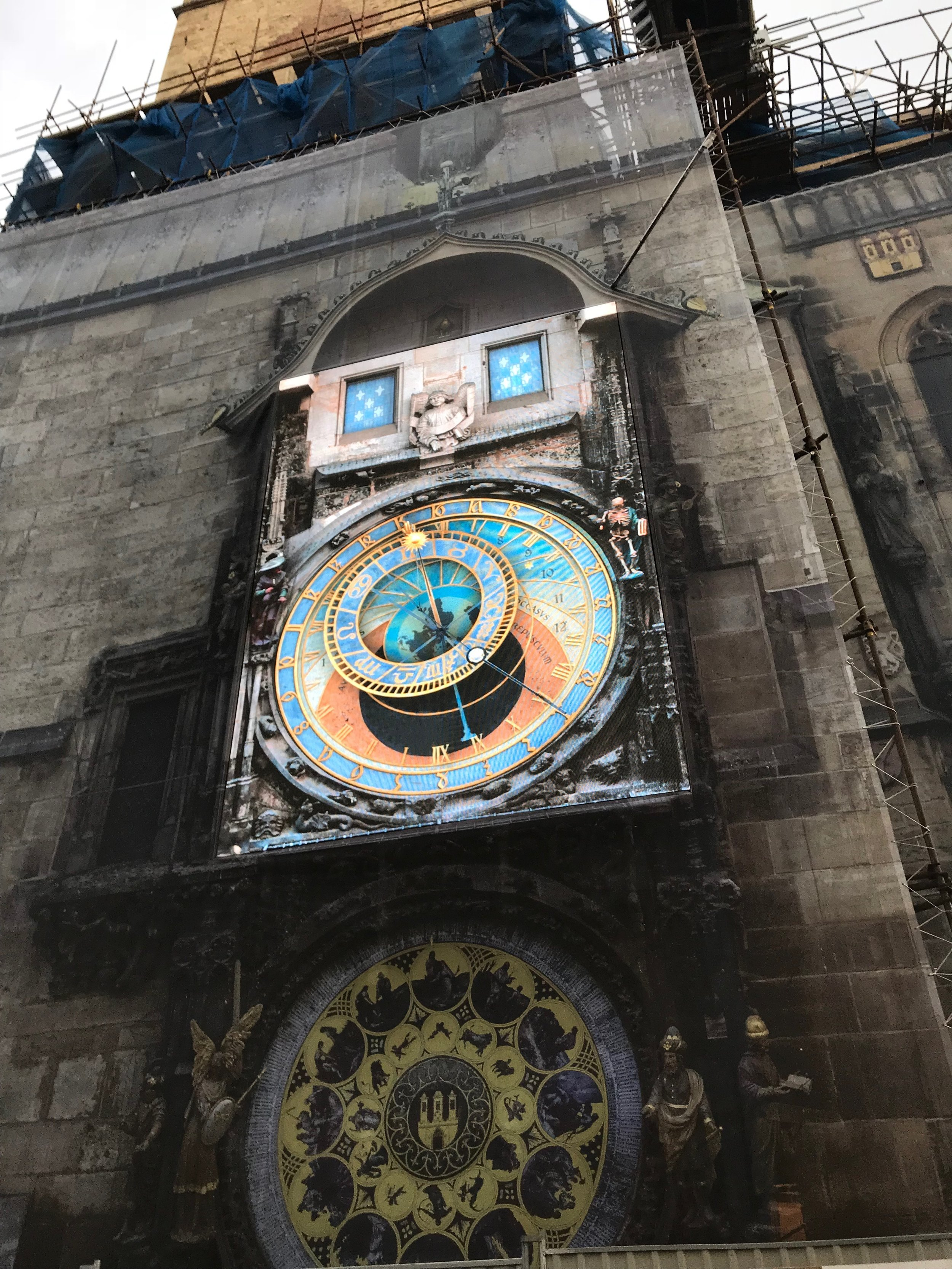 In November, they were restoring the clock. It was the 1st of June and the situation was still the same. And, according to the official website of Prague, the clock will not be able to offer her beauty until October 2018.
