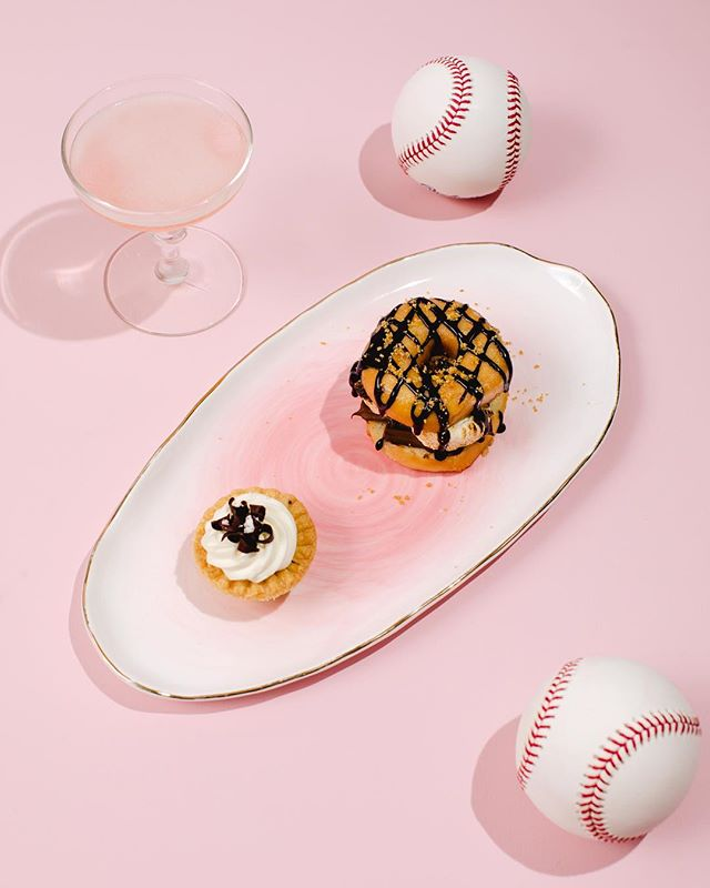 batter up and up on @brides (see the feature 👆) ...this fun loving couple served a dessert line up that would make you drool. see their 8 foot tall wheel of desserts by @occasionscaterers including this donut s'more. w. @pineappleprodc @kristrn @tvturner. featured on @brides