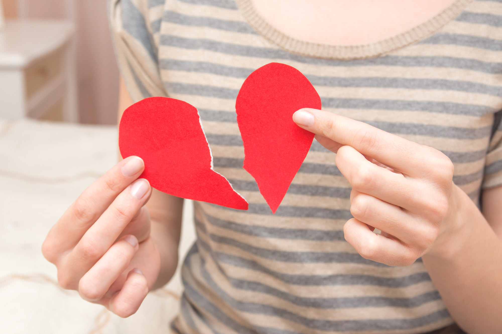 Broken heart in hands
