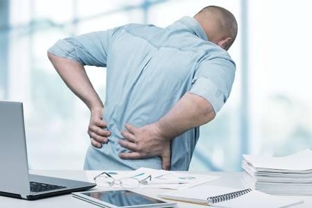 82573708-back-pain-in-office-.jpg