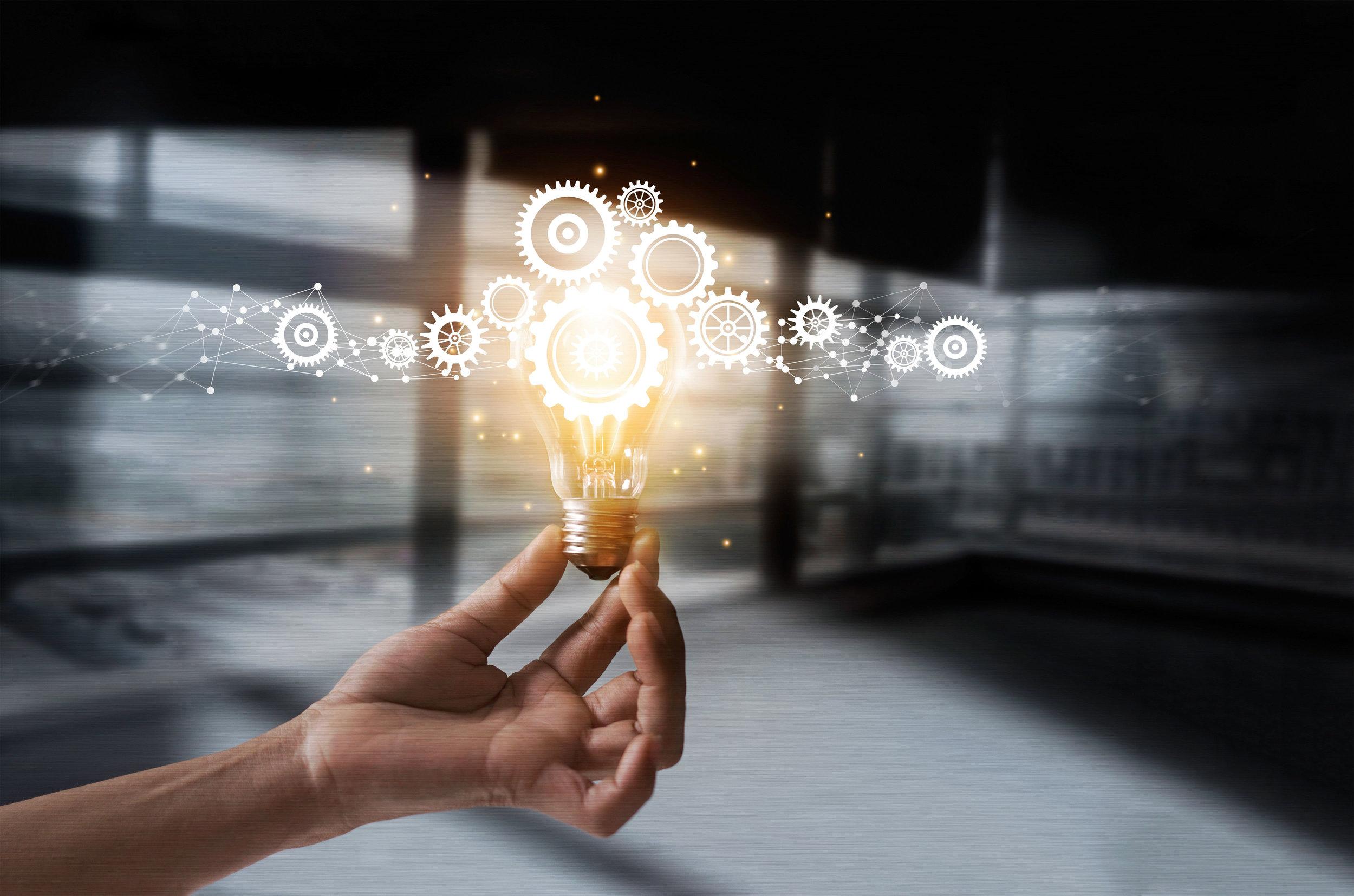 Ideation, idea, lightbulb, with hand-iStock-962094570.jpg