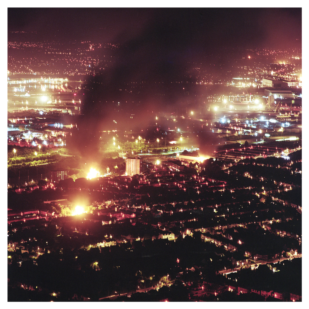A view over Belfast on the 'Eleventh Night; a night when  Unionist communities burn bonfires, to commemorate the annual 12th of July, again indicating there is still some way to go in building a shared future.