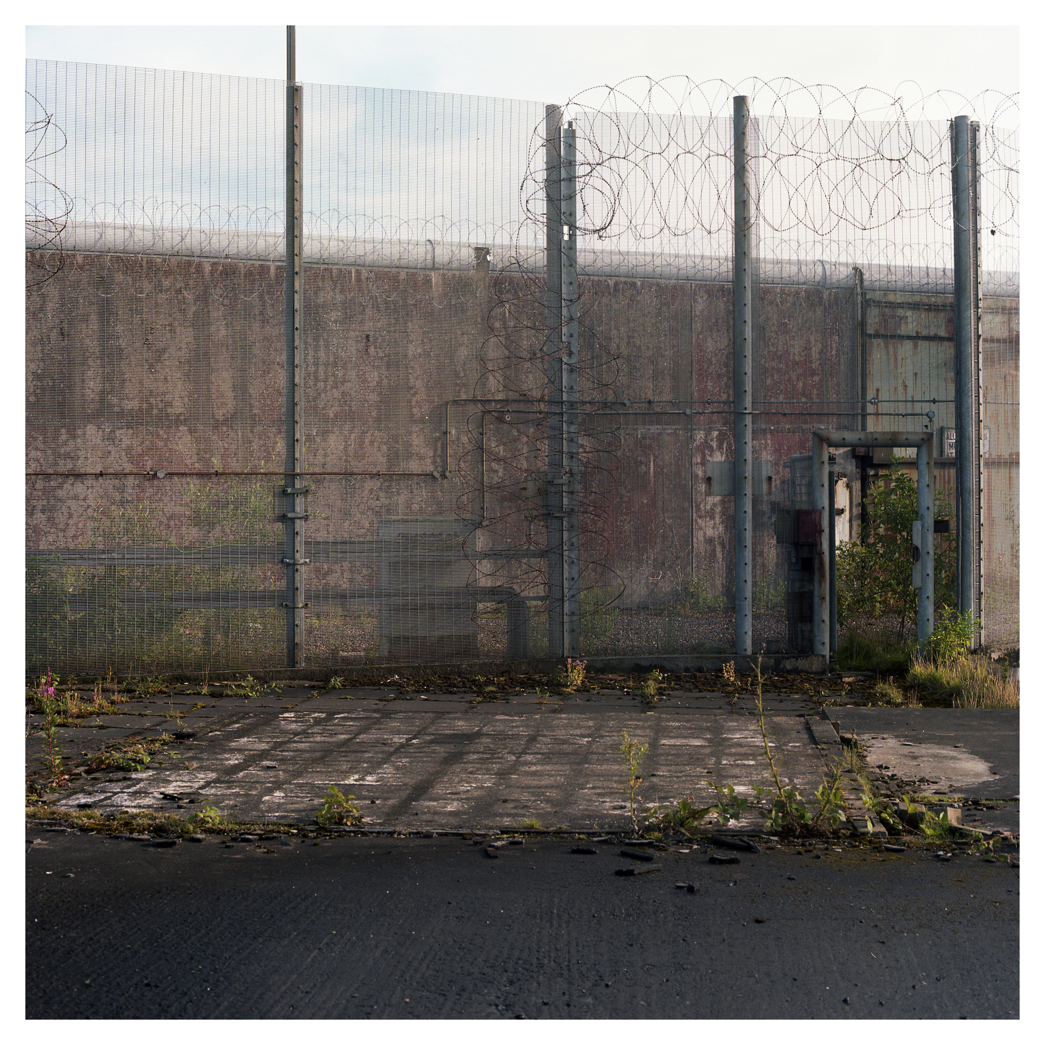 What remains of the former prison site falls into disrepair.