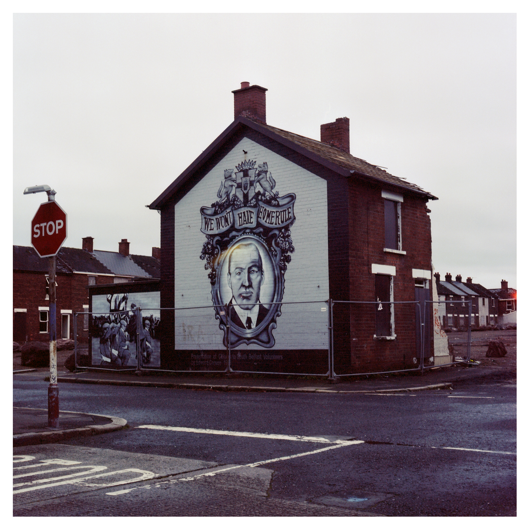 An end terrace house with a mural depicting Edward Carson,who was the leading figure in the campaign against the Home Rule Bill & the first signatory of the Ulster Covenant), prior to demolition.