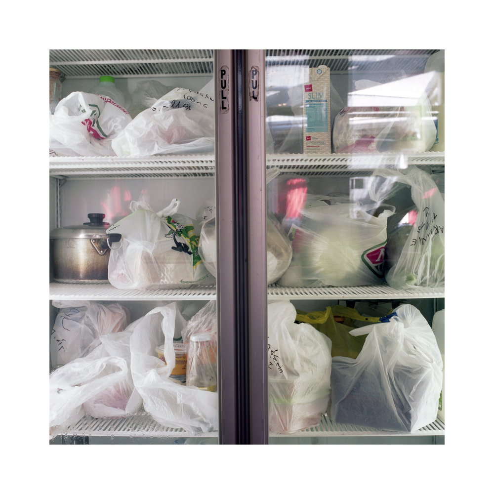 Fridge - Hogwarts BBH, Dunedin.  Backpackers perishable food stuffs in the communal fridge identified by; name, room number, and date marked on the plastic bag. Food is often left in Hostel's fridges by departing guests. Without such an identification system the forgotten food spoils making the fridge unhygienic for the remaining guests.