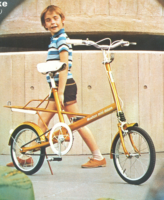 Moulton Mini, a British designed and build commuter bike with the tiniest wheels. (that's NOT me in the photo)