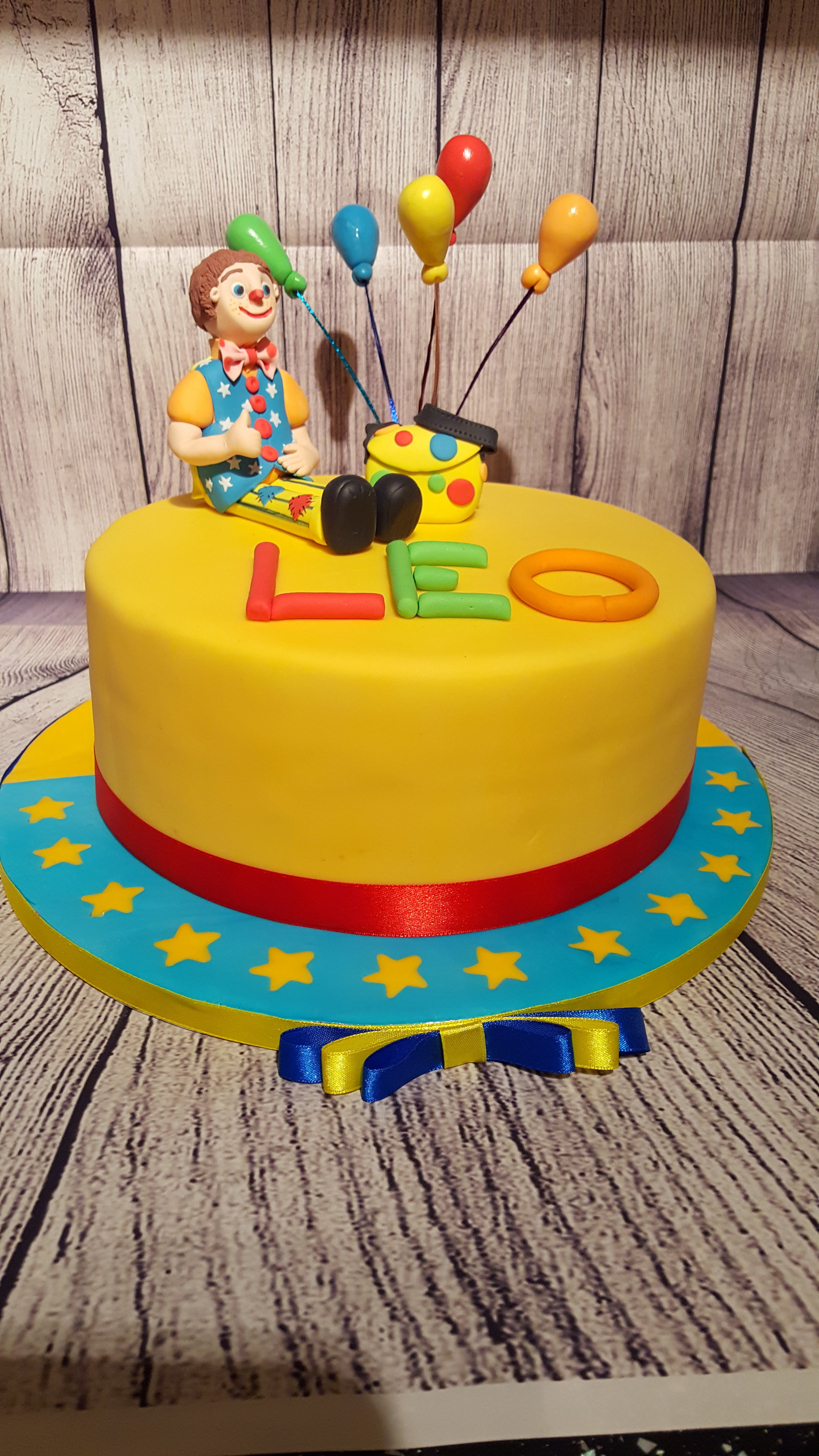 """Mr Tumble Cake £45 - 8"""" round filled cake with a model of Mr Tumble and name of your child."""