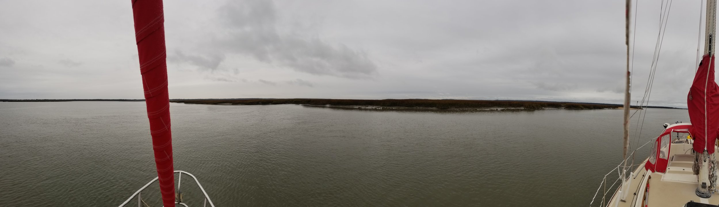 Anchored in the Bear River surrounded by marshland without any signs of civilization.