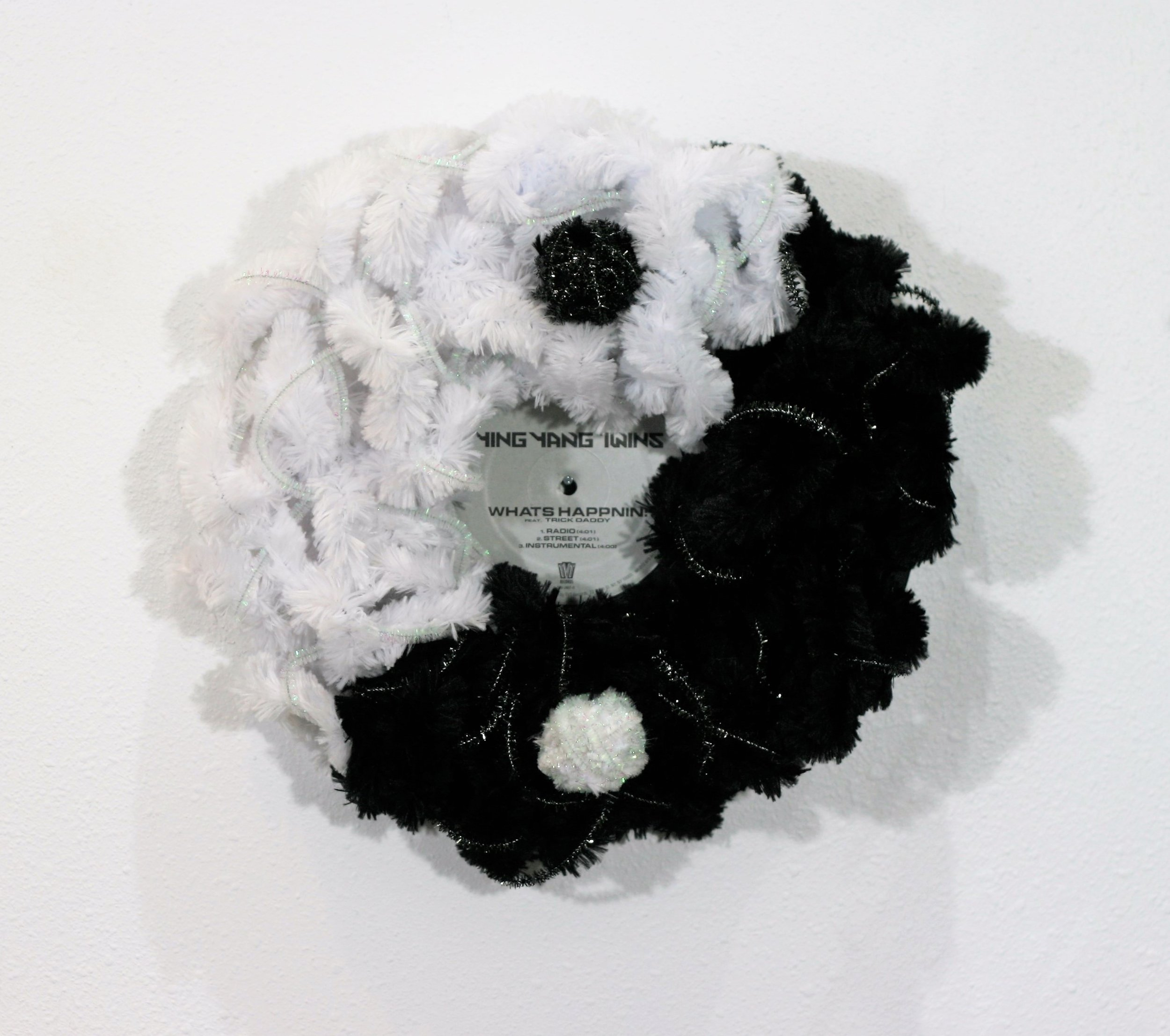 """There is no Ying - Mixed Media12"""" diameter x 3""""2019** Available for purchase. This is a fun piece! First of all, it all began when my mom and I were chatting and I had always thought that it was """"Ying and Yang"""" and she told me that it is """"Yin and Yang"""" and my response was """"Oh… there is no Ying"""". We laughed and thought that is a great title for an art piece!As we chatted about this art piece we then thought it would be clever for the base of the art piece to be a Ying Yang Twins record. As I started to research more about about Yin and Yang, I love the concept being about dualism, how opposites are interconnected in the natural world and each have a little of each other within. We are each a package. No one or no thing is one sided, we are multidimensional."""