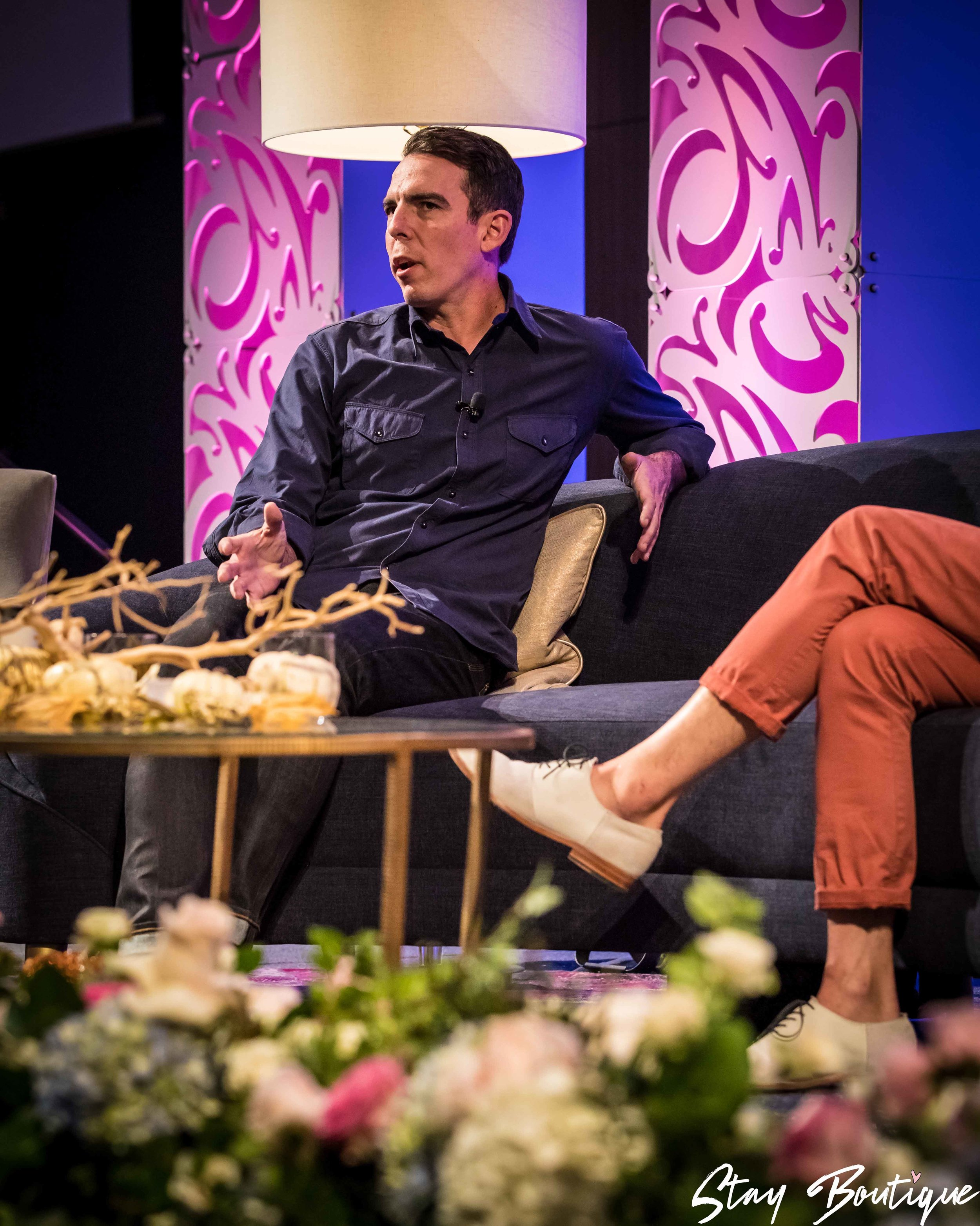 Colby on stage at the 2017 Stay Boutique Conference.jpg