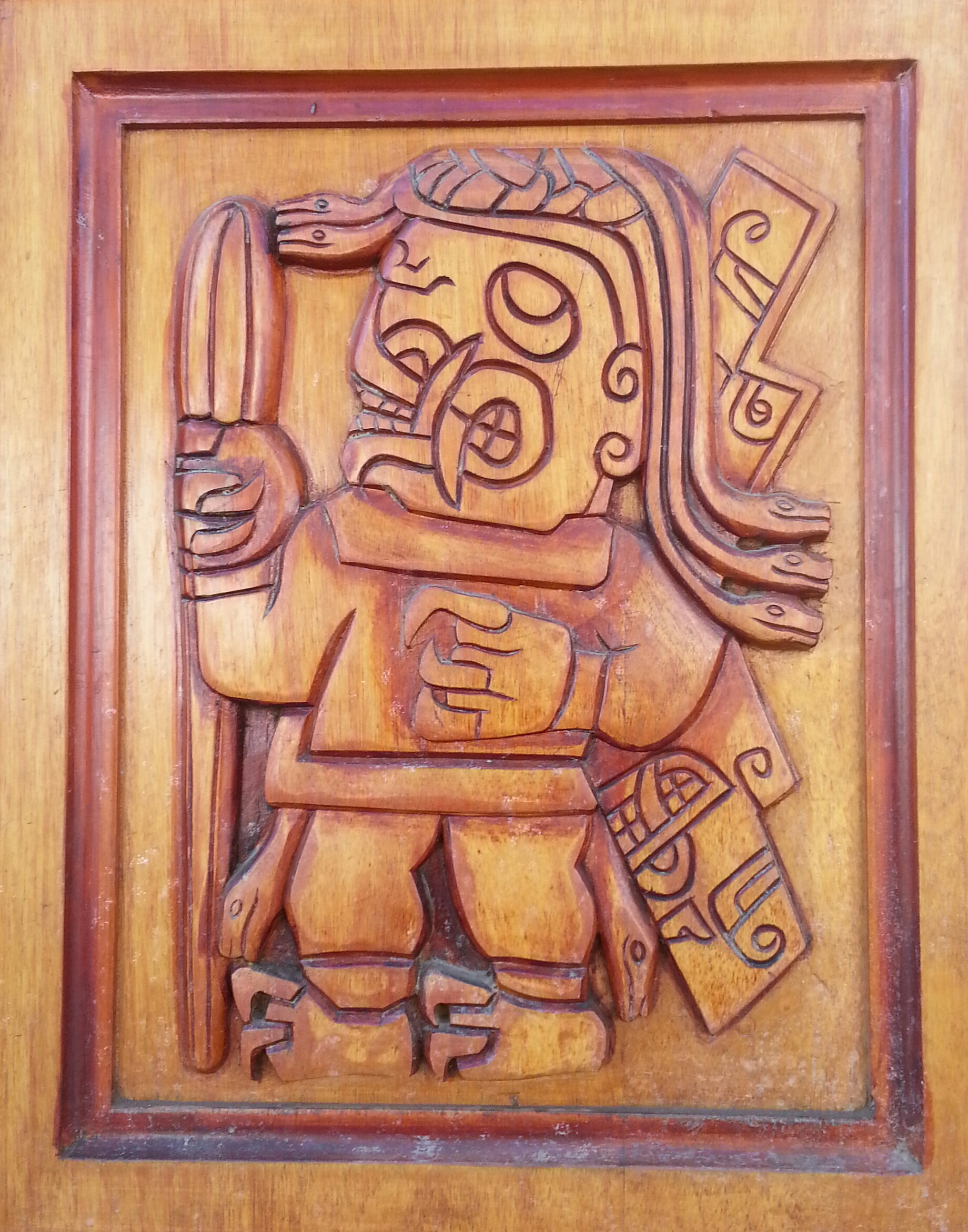 Carving on a door in town of a Chavin deity holding Huachuma.