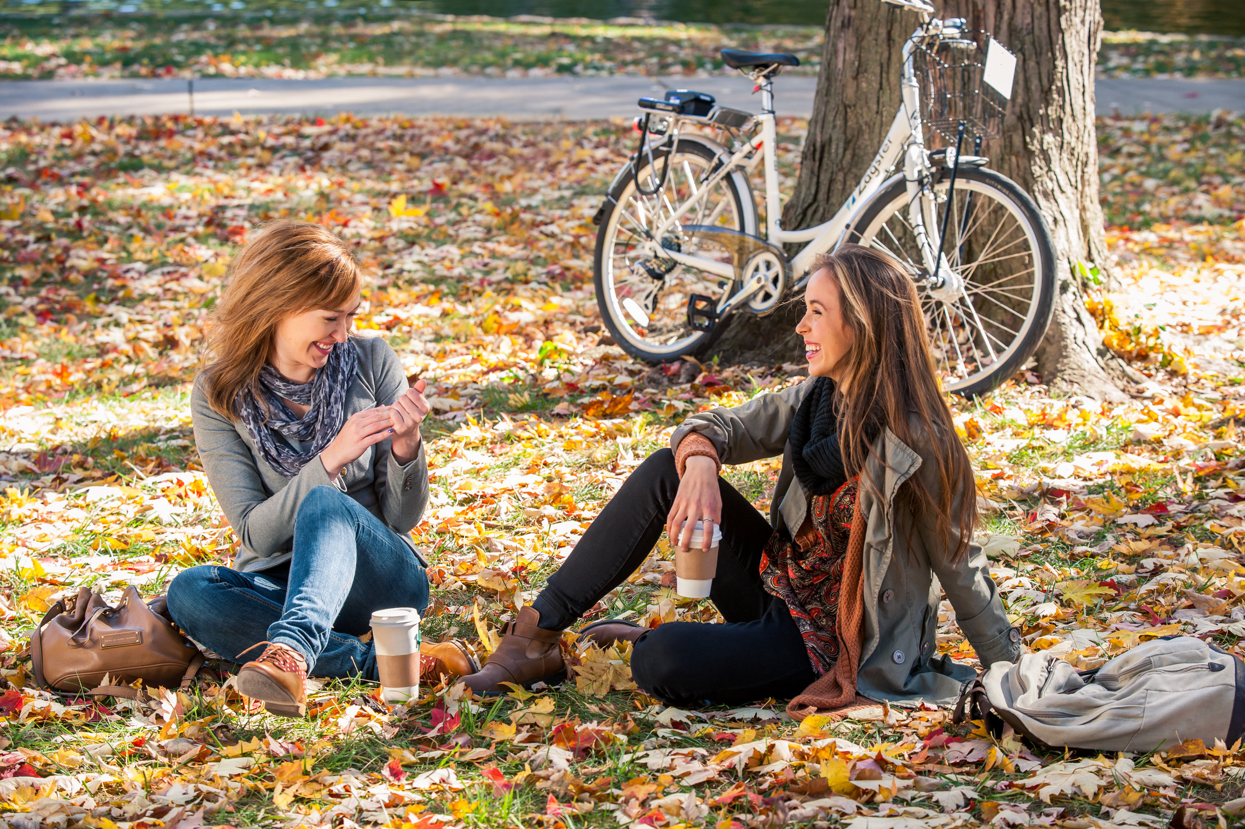 When we made this image, there was a really annoying lamp post almost growing out of Jess's head. We also had to nix some branding off of everyone's favorite overpriced coffee. Beyond that, these are two real girl's, enjoy real coffee, on a really beautiful fall day.