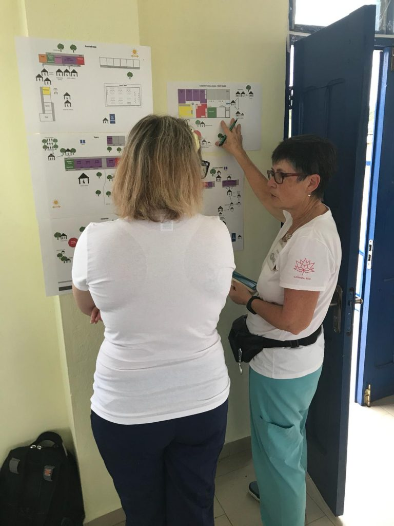 Nursing leaders Joan and Sandra poring over clinic maps.