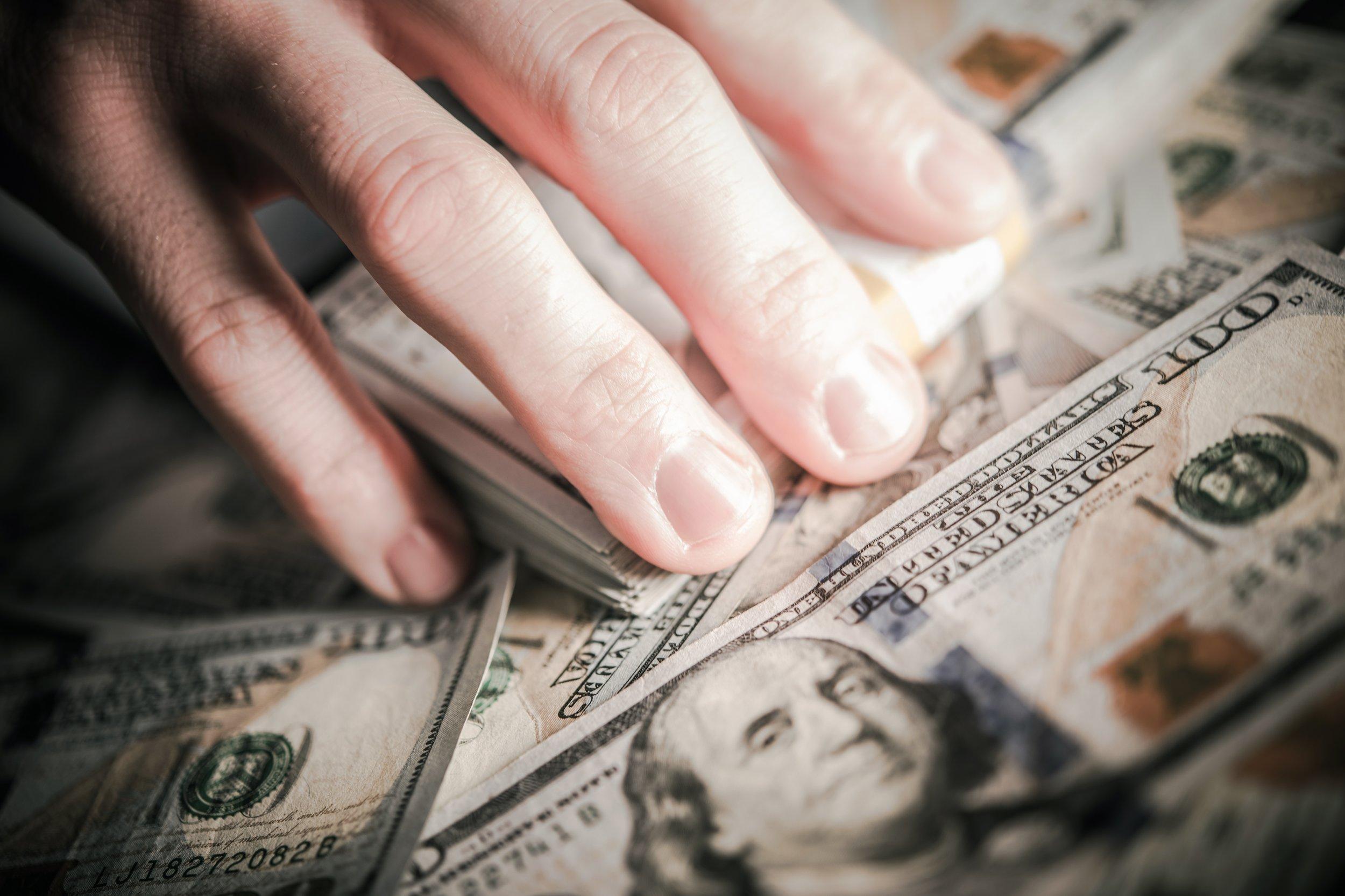 hands-on-the-money-PPZ7NAJ.jpg