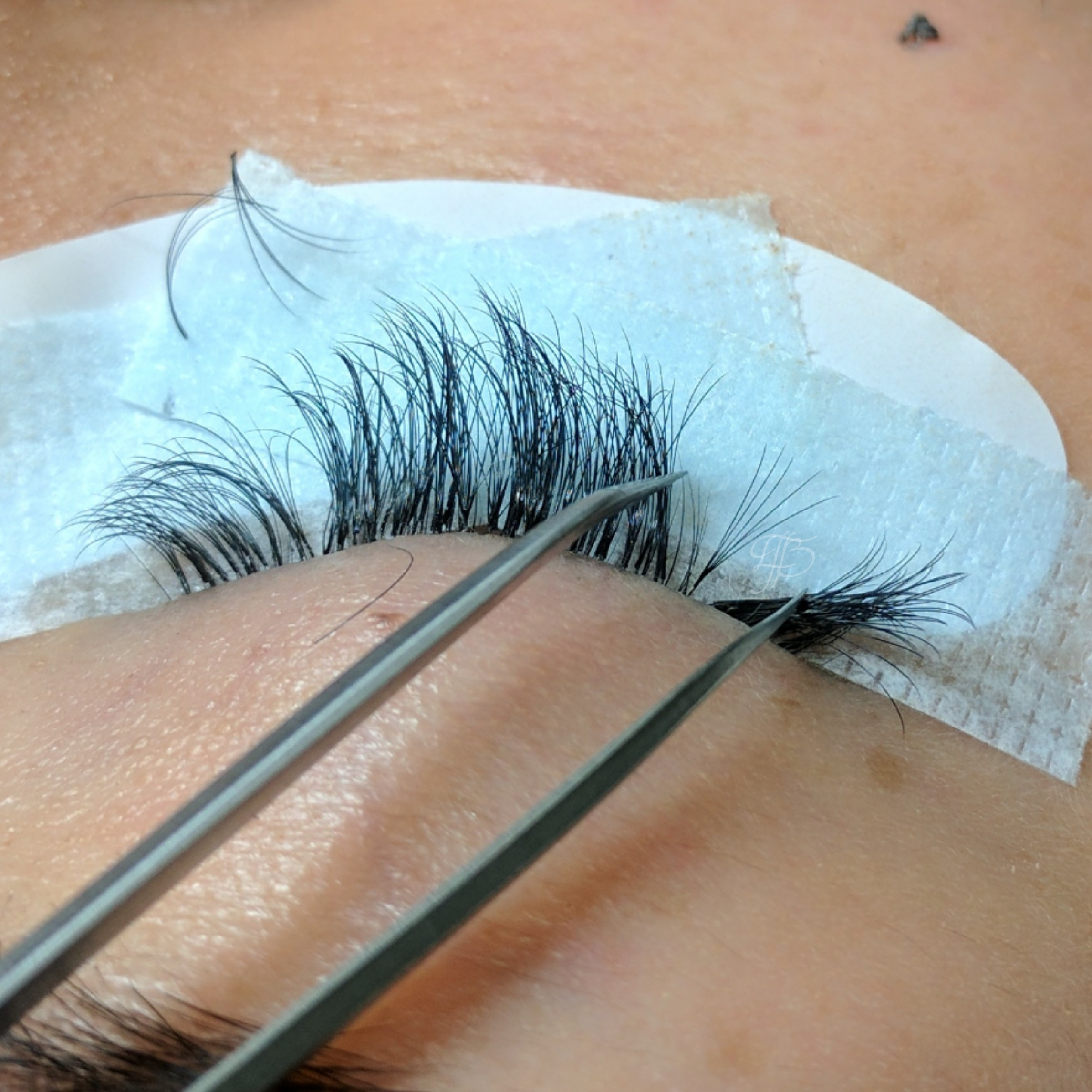 isolation of a single natural lash with a volume extension attached