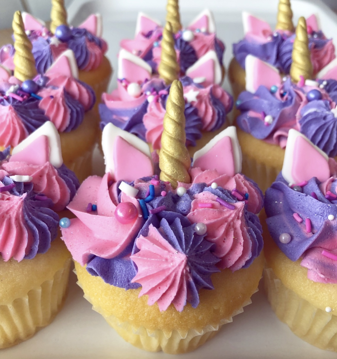 UNICORN CUPCAKES - 12 for $50  So popular it has joined our family!  Minimum order of a dozen. Choose either a Vanilla or Chocolate cake base.   **Please note colours and sprinkles may vary depending on availability**    PLEASE ALLOW 48 HOURS NOTICE - NOT AVAILABLE FOR NEXT DAY PICK-UP