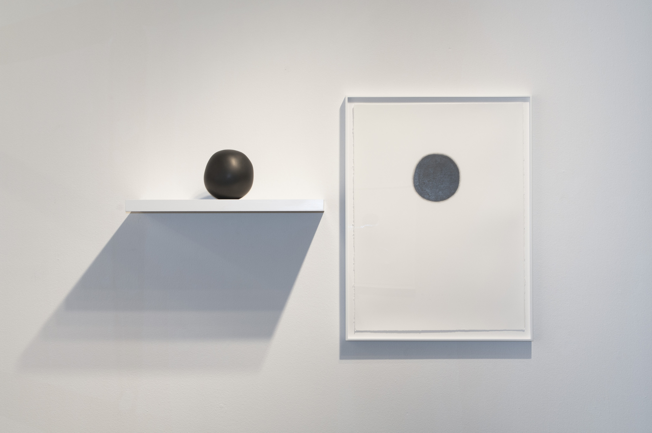 """Daily Practice: Circle Drawings, Day 26, Ucross, 2010  30"""" x 22"""" (paper size), Graphite pencil on paper  Sphere, no. 26, 2010, 5"""" x 4"""" x 4.25"""", Solid graphite"""