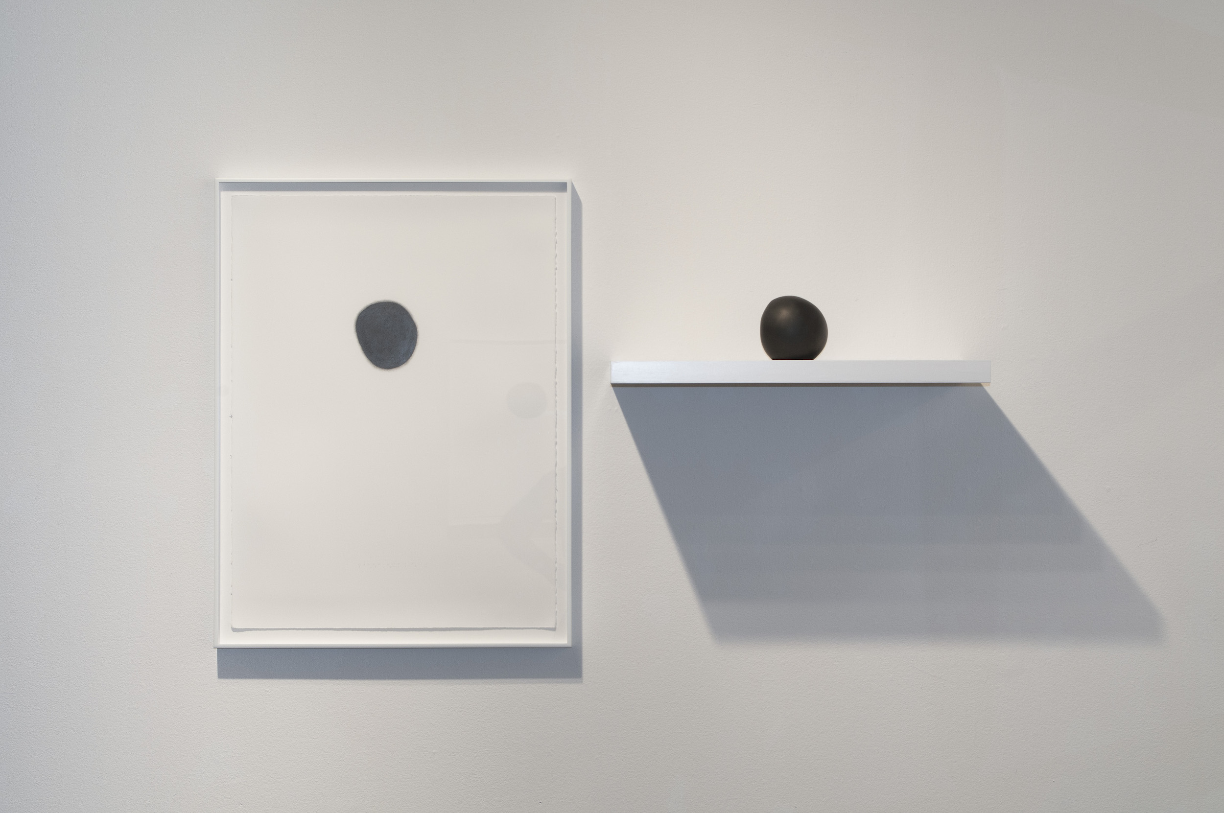 """Daily Practice: Circle Drawing, Ucross, Sphere no.1, 2012  Circle Drawing: graphite pencil on paper, 30"""" x 22""""  Sculpture: solid graphite"""