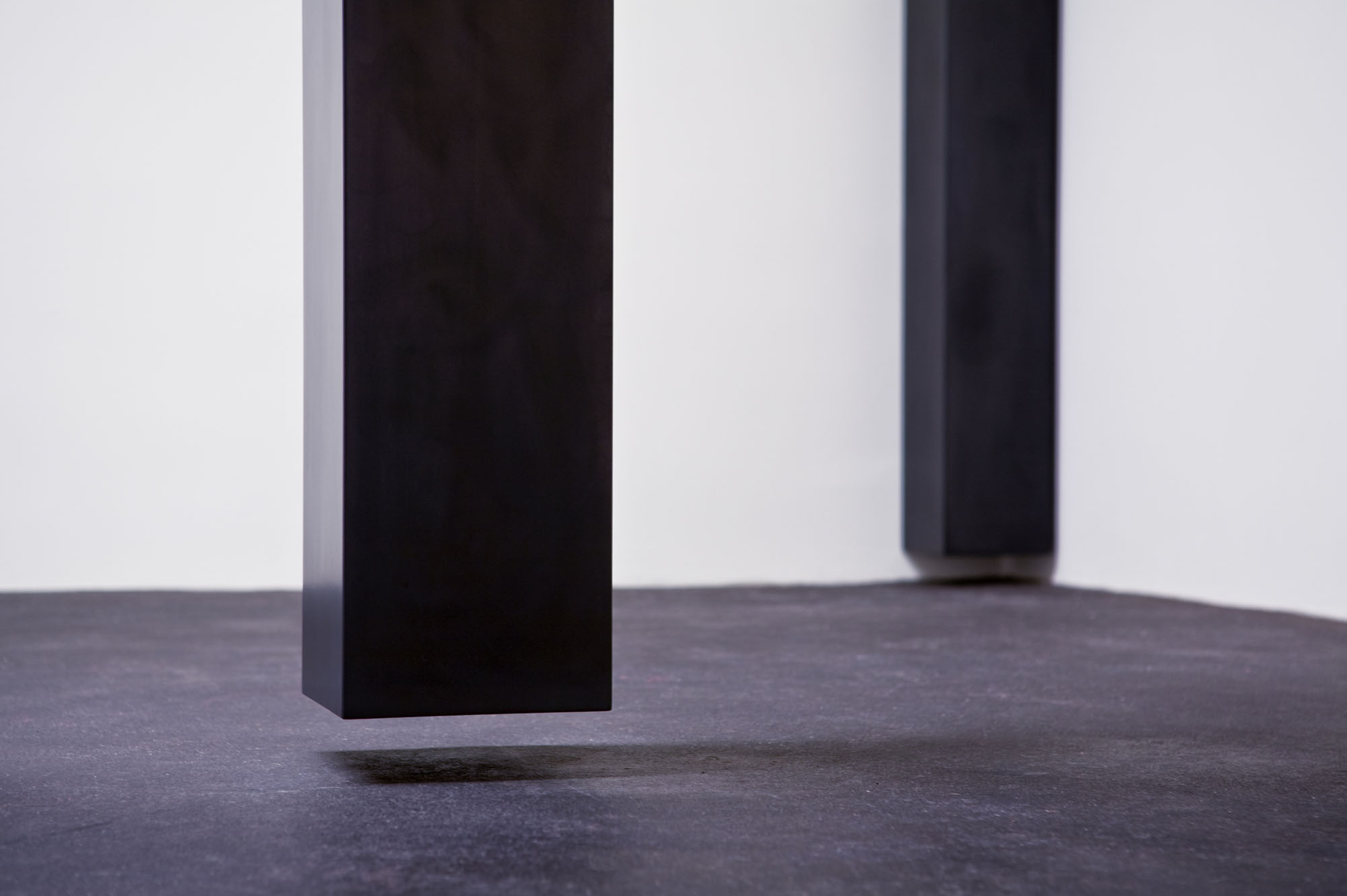"""Floating Column, 2008 (detail view)  Solid graphite, 14' x 10"""" x 9.5""""  Lannan Foundation collection. Photo: Jamey Stillings"""
