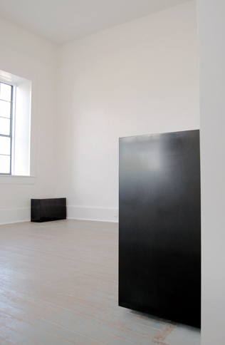 """2d Exhibitions, 2015 (installation view)   Double Golden Mean Rectilinear Solid, 2007 (foreground)  Solid graphite,16"""" x 25.75"""" x 9.75"""""""