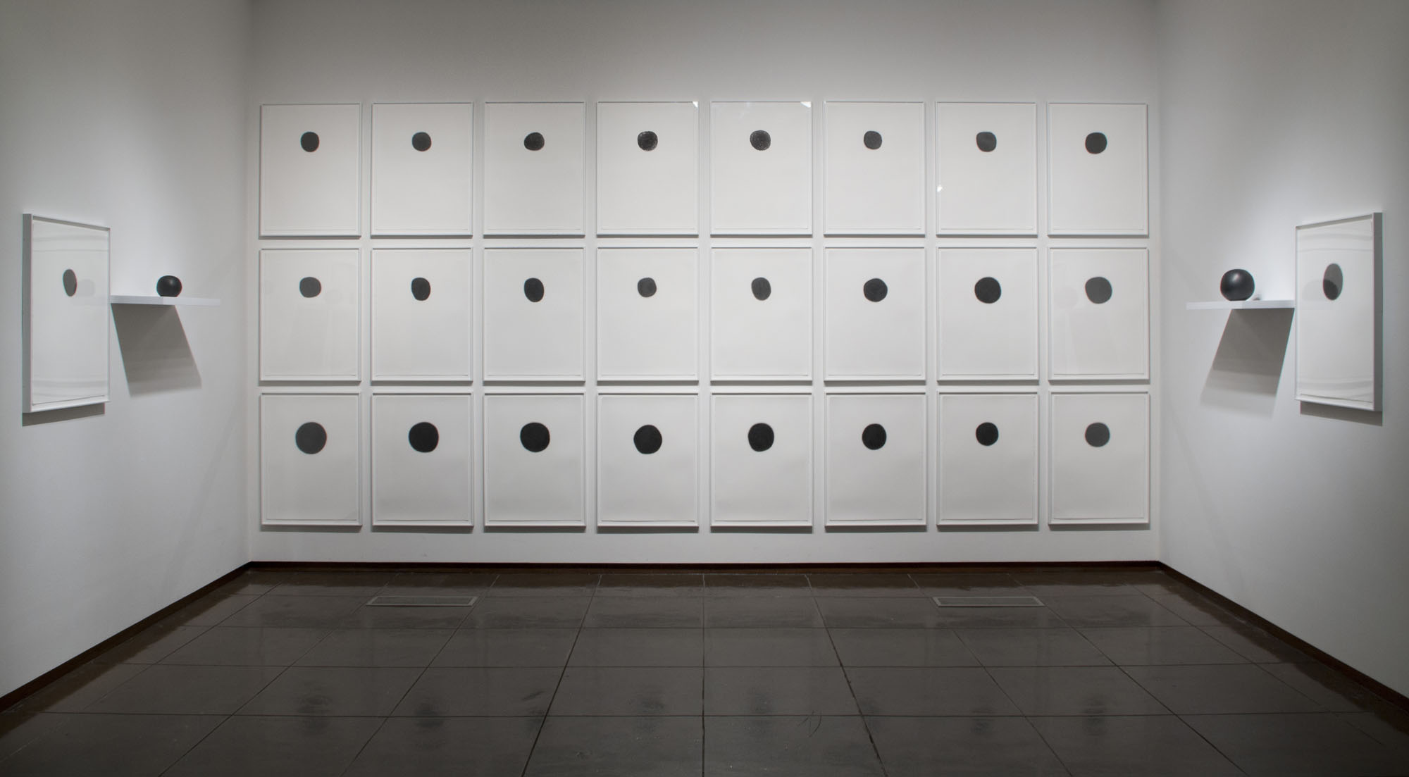 Alcoves 12.5 (installation view, New Mexico Museum of Art, 2015)   Daily Practice: Circle Drawings, Day 1-26, 2010, Graphite pencil on paper   Ucross Sphere no.1 and no. 26, 2010, Solid Graphite