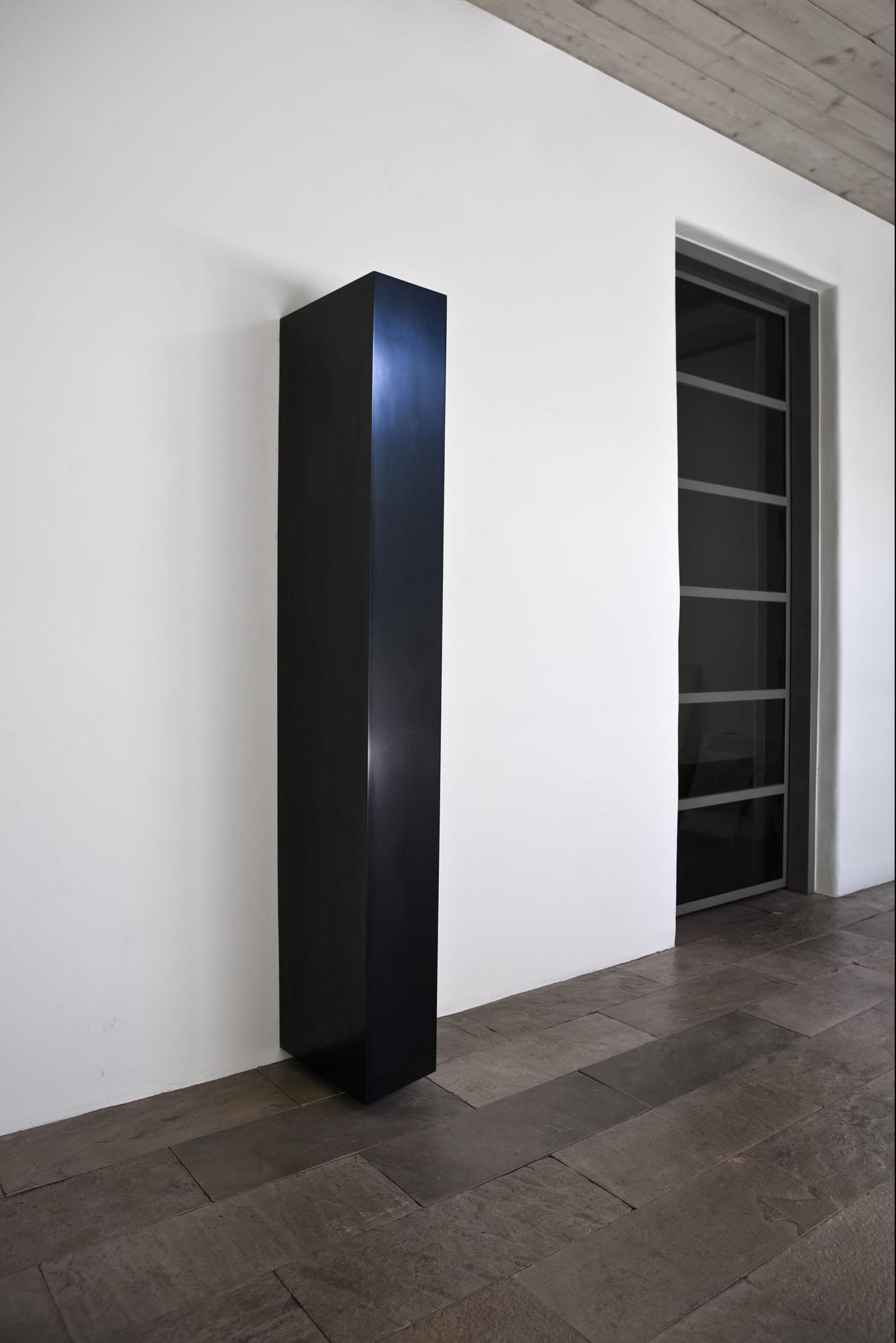 "Tiltled Column, 2008  Solid Graphite,70"" x 14"" x 15""  Photo: Jamey Stillings; courtesy of Lannan Foundation"