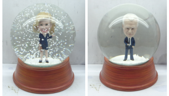 Snowglobes made of Paperstormed politicians