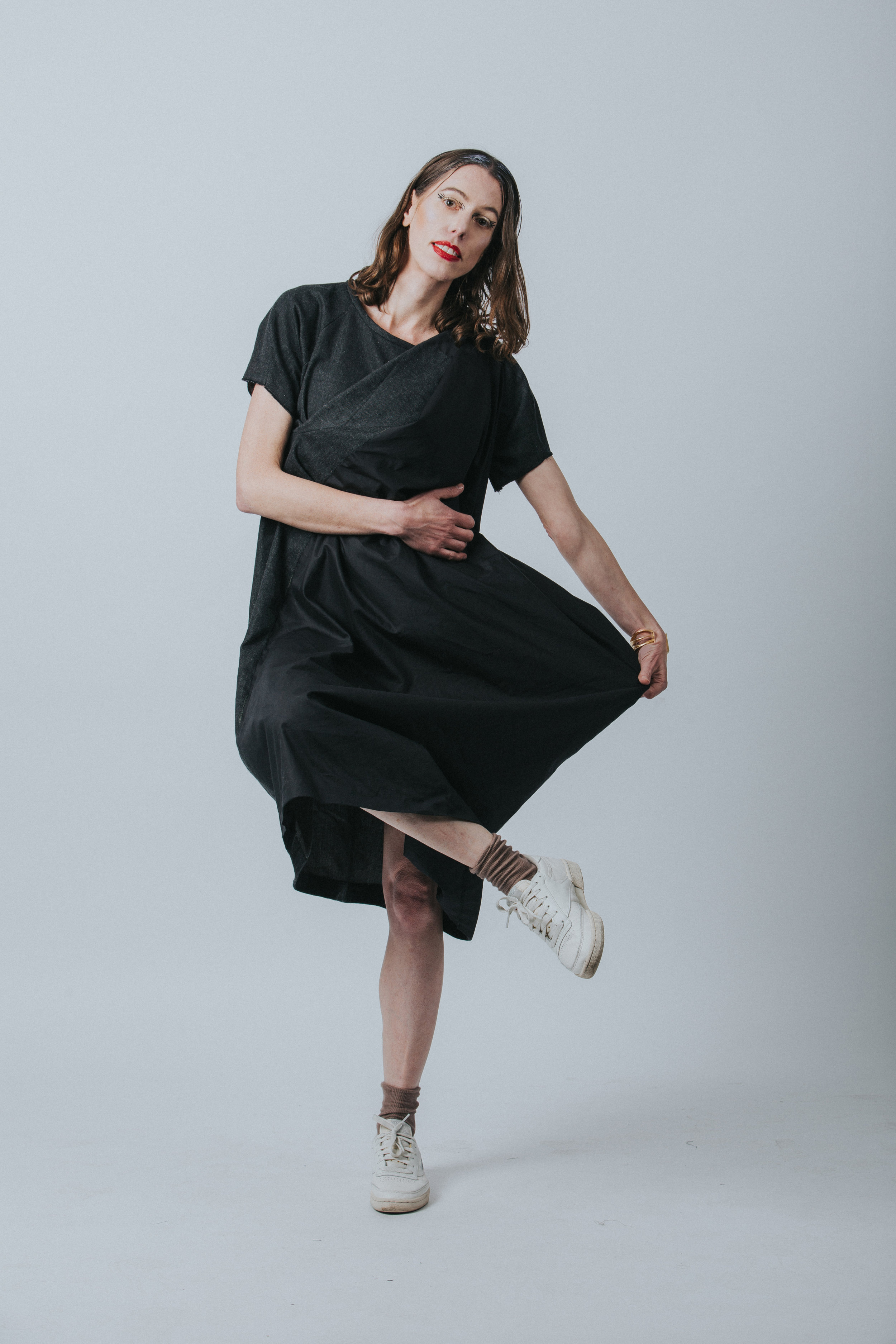 Vanessa Smuts, London. - Vanessa is wearing Anatomic little black reconfigurable 100% organic cotton dress.A little background about you I was born in South Africa in the seventies. I'm fortunate to count myself and my friends among the misfits of society. I have a strong sense of fairness (a typical Libran trait) and have yet to grow out of my teenage existential angst. I cherish the experience gained with age, and continue to search for the meaning of life. I hope some day to do it justice. I'm vegetarian and run to stay fit and remain sane. If there is such a thing as reincarnation, I'd like to return as a poet or a musician.What was your biggest creative influence(s) growing up ?I grew up on a bushveld farm in South Africa. The world beyond was gleaned from pictures of glamorous women posing in the pages of my grandmother's weekly issue of Fair Lady or Cosmopolitan, and fleeting glimpses of big cities like New York on b&w TV where the sidewalks were a sea of human faces bobbing on the tide. It was frightening yet fascinating. I especially wanted to visit Japan one day. Nature has been my greatest inspiration but I also learned that it is