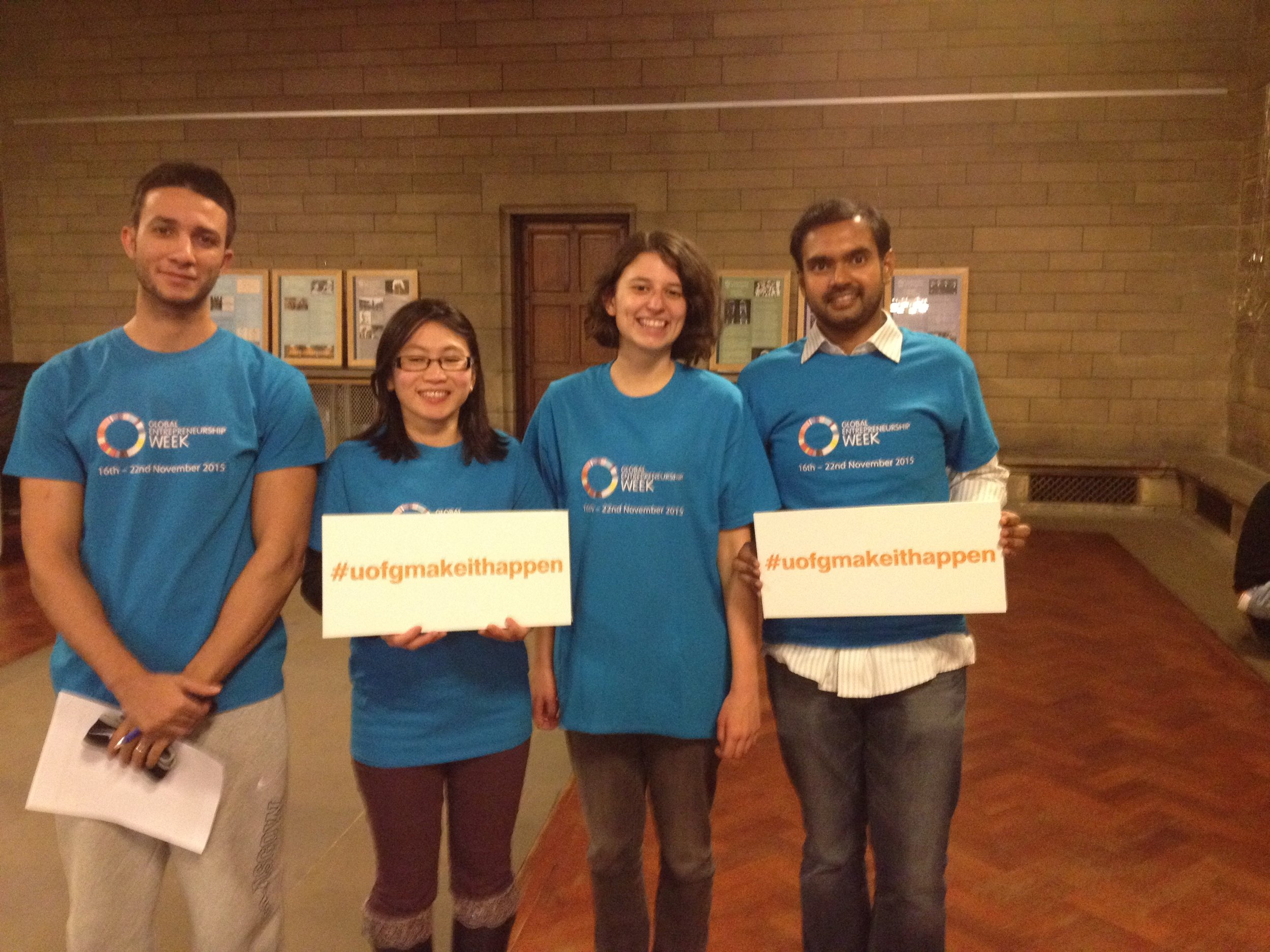 GEW15 volunteers wearing the bright blue branded T-shirts and signs displaying the #uofgmakeithappen hashtag