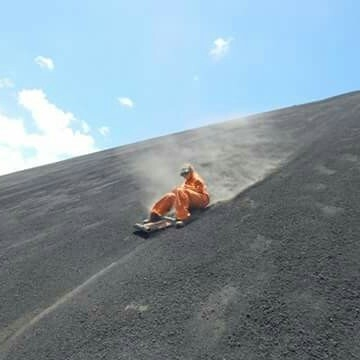 Sapphire skating down a hill in an orange jumpsuit
