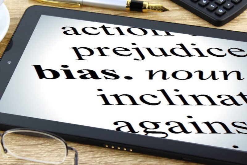 An image of tablet showing a close up view of the dictionary definition of bias. Only part of the definition is visible.