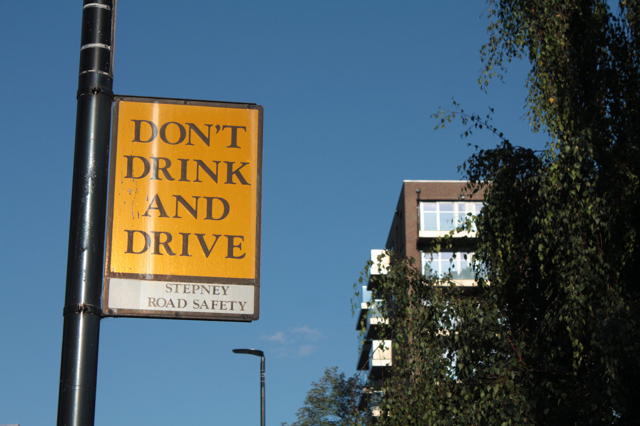 Yellow street signage stating: 'Don't drink and drive'