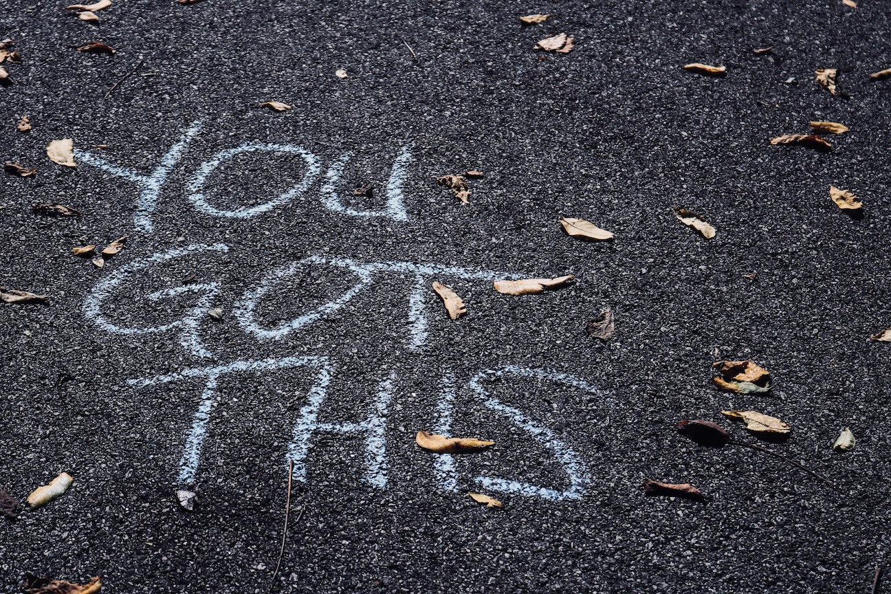 [Image Description: The words 'You Got This' are written in chalk on an asphalt ground, surrounded by leaves.]