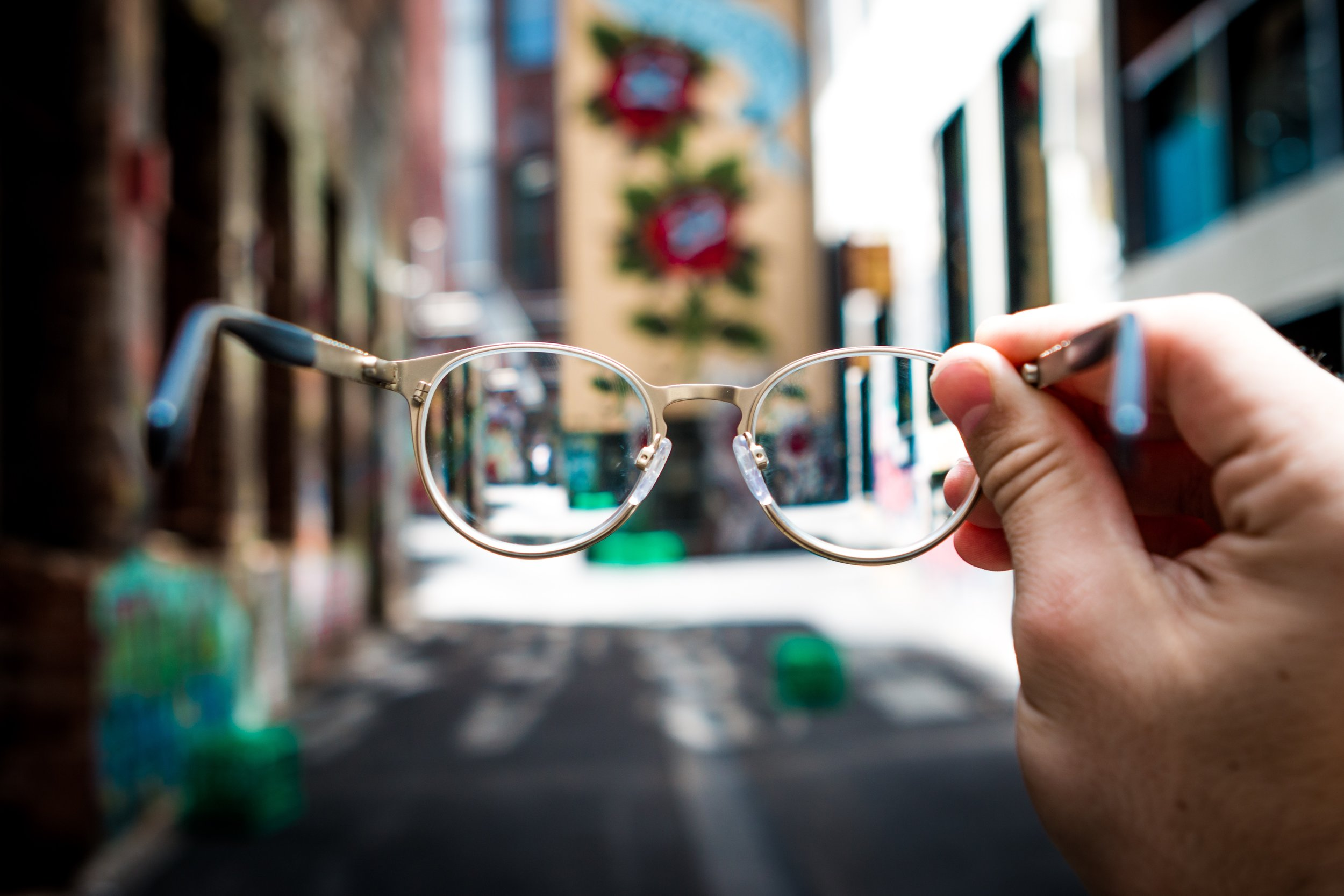 Hands holding a pair of glasses