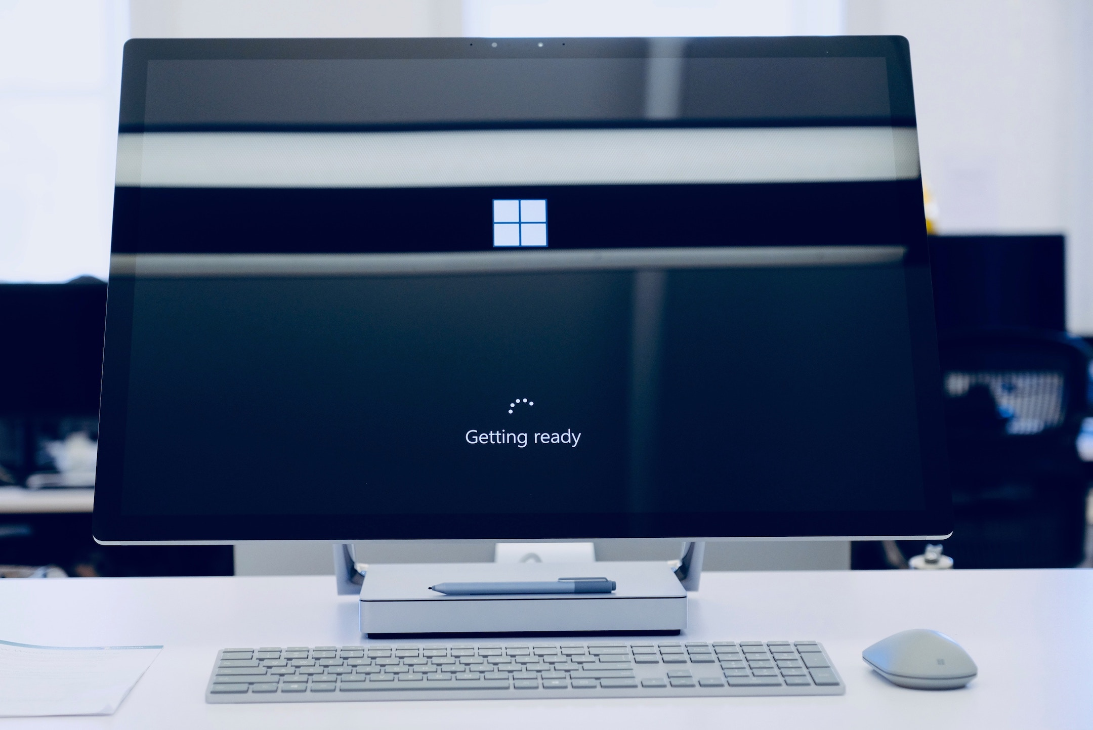 [Image Description: A large desktop computer screen sits above a keyboard and mouse and the screen says 'Getting ready'.]