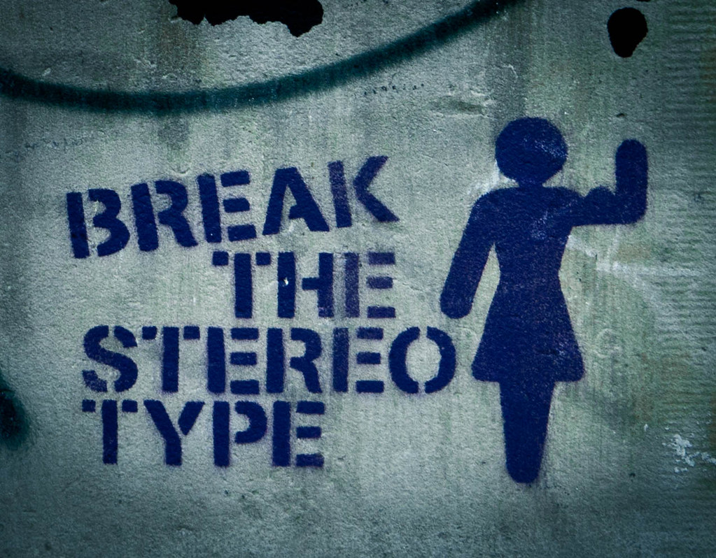 Graffitti of a women icon saying 'Break the stereotype'
