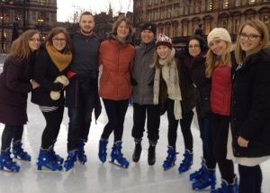 [Image Description: Dr Ninegeer stands with a group of friends on an ice-skating rink.]