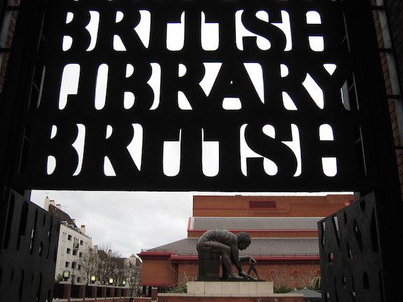 [Image Description: A sign that reads 'British Library/British' is shown in front of a statue of a man using a protractor. These are outside the British Library.]